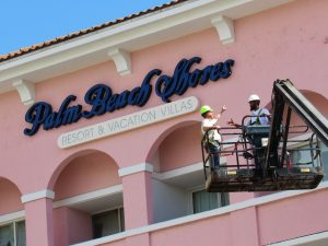 Up Close Building Signage of Palm Beach Shores Resort Vacation Villas